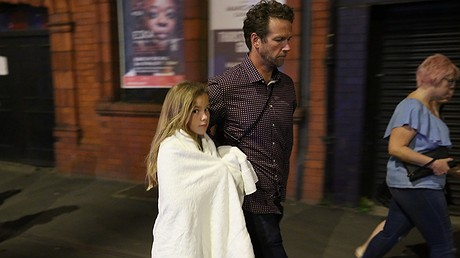 A young girl is escorted away from the Manchester Arena after an explosion at an Ariana Grande concert on May 23, 2017, in Manchester, England. Photo by: Christopher Furlong/Getty Images