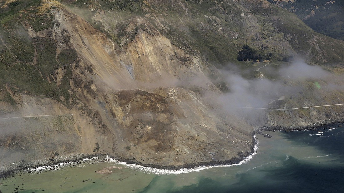 This aerial photo taken May 22, 2017, shows a massive landslide along California's coastal Highway 1 that buried the road under a 40-foot layer of rock and dirt. A swath of the hillside gave way in an area called Mud Creek on May 20, covering about one-third of a mile of road and changing the Big Sur coastline. Photo by: John Madonna via AP