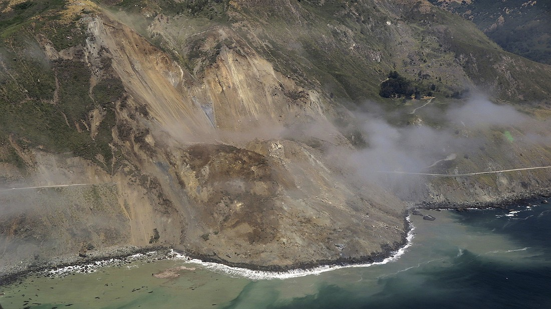 This aerial photo taken Monday, May 22, 2017, provided by John Madonna, shows a massive landslide along California's coastal Highway 1 that has buried the road under a 40-foot layer of rock and dirt. A swath of the hillside gave way in an area called Mud Creek on Saturday, May 20, covering about one-third of a mile of road and changing the Big Sur coastline. Photo by: John Madonna via AP