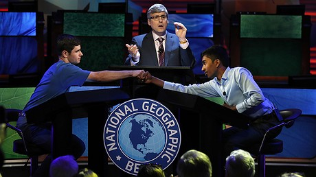 Host Mo Rocca (center) applauds as (at left) Thomas Wright, 14, of Milwaukee, Wisconsin, congratulates Pranay Varada, 14, of Carrollton, Texas, on winning the 2017 National Geographic Bee on May 17, 2017, at the National Geographic Society in Washington, D.C. AP Photo/Jacquelyn Martin