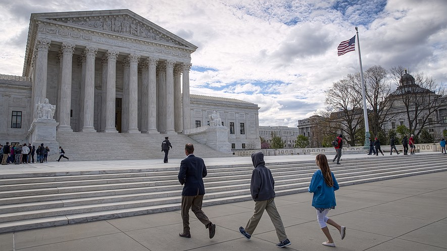 "Visitors arrive at the Supreme Court building in Washington, D.C. The Supreme Court on May 15, 2017, rejected an appeal to reinstate North Carolina's voter identification law that a lower court said targeted African-Americans ""with almost surgical precision."" AP Photo/J. Scott Applewhite"