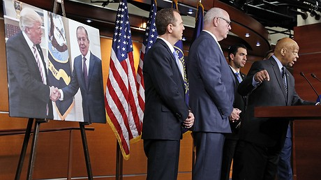 Representative Elijah Cummings of Maryland, accompanied by (from left) Representatives Adam Schiff of California, Joseph Crowley of New York and Ruben Kihuen of Nevada, speaks during a news conference on May 17, 2017, in Washington, D.C. A poster behind them shows President Donald Trump and Russian Foreign Minister Sergei Lavrov shaking hands during a May 10, 2017, meeting in the Oval Office of the White House. Photo by: AP Photo/Alex Brandon