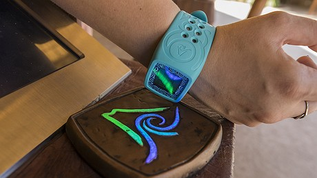 This photo provided by Universal Orlando Resort shows the wristband visitors will wear at the new Volcano Bay water park in Orlando, Florida. The wristband, called Tapu Tapu, tells you when it's your turn to get on a ride so you don't have to wait on line. It also lets you pay for food so you don't have to carry a wallet and opens lockers so you don't have to carry a key. Photo from Universal via AP