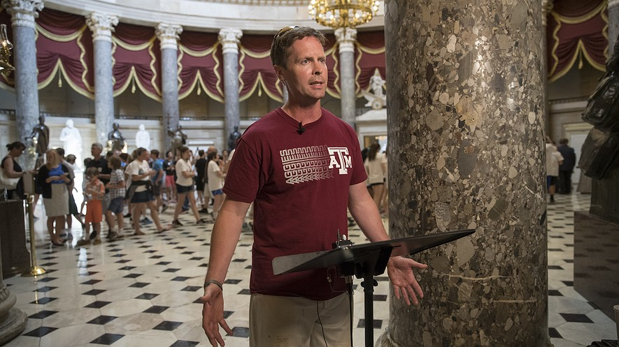 Representative Rodney Davis, a Republican from Illinois, still wearing his baseball uniform, describes for reporters on Capitol Hill in Washington,D.C., the scene during the June 14, 2017, shooting at a congressional baseball game in Alexandria, Virginia, where House Majority Whip Steve Scalise of Louisiana and others were shot. Photo by: AP Photo/J. Scott Applewhite