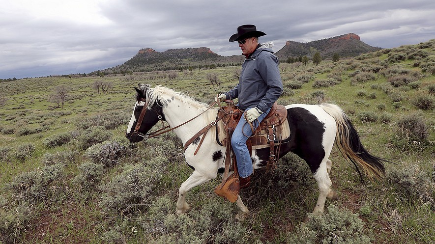 Interior Secretary Ryan Zinke rides a horse in the new Bears Ears National Monument near Blanding, Utah, May 9, 2017. Zinke on June 12 recommended that the new national monument in Utah be reduced in size and said Congress should step in to designate how selected areas of the 1.3-million-acre site are managed. Photo: Scott G Winterton/The Deseret News via AP