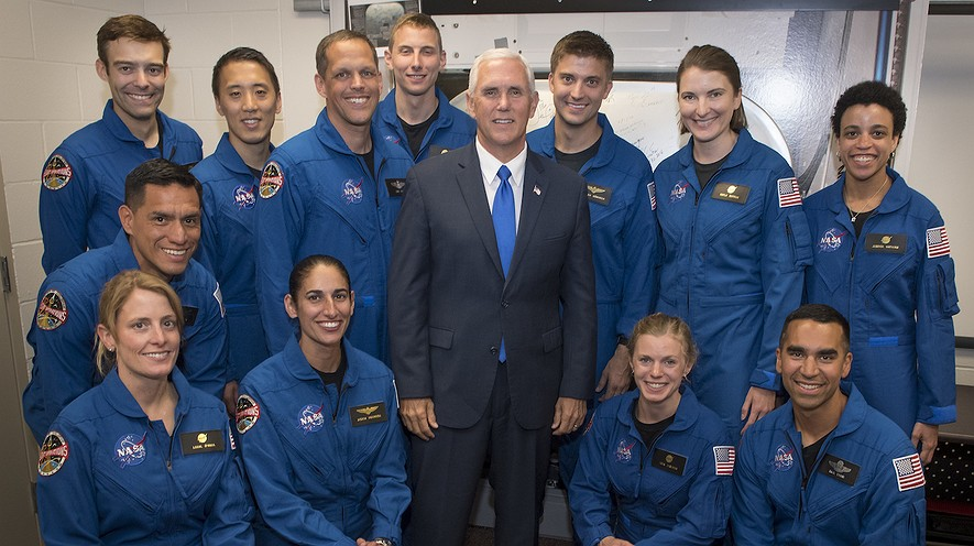 Vice President Mike Pence (center) poses for a group shot with NASA's 12 new astronaut candidates on June 7, 2017, at NASA's Johnson Space Center in Houston, Texas. NASA chose the 12 new from its biggest pool of applicants ever, selecting seven men and five women who could one day fly aboard the nation's next generation of spacecraft. Photo from Bill Ingalls/NASA via AP