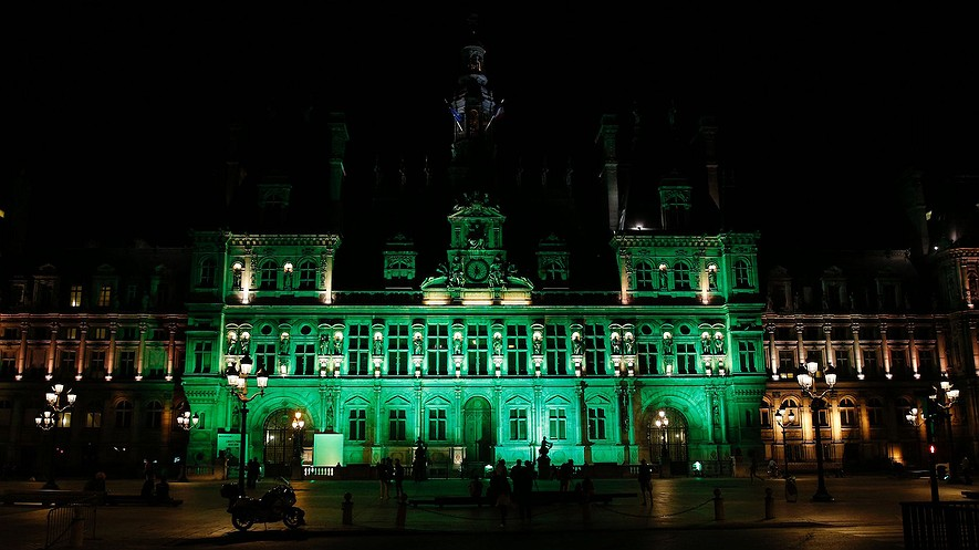 The Paris City Hall is illuminated in green to show France's support for the Paris climate agreement on June 1, 2017, after President Donald Trump announced the United States will withdraw from the climate pact. The U.S. will join Syria and Nicaragua as the only countries in the world, out of 197, not part of the agreement. Photo by: Geoffroy Van Der Hasselt/AFP/Getty Images