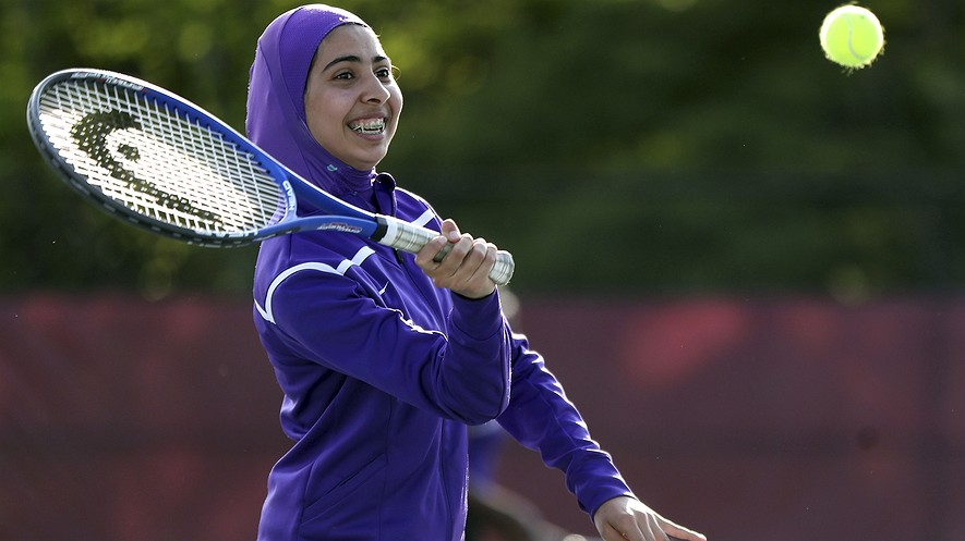 Tabarek Kadhim, a sophomore at Deering High School in Portland, Maine, wears a sport hijab while playing a tennis match in Windham, Maine, May 24, 2017. Deering High is providing sport hijabs with the goal of making Muslim girls comfortable and boosting their participation in sports. Photo by: AP Photo/Robert F. Bukaty