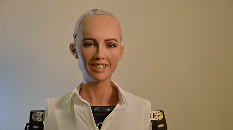Sophia, the robot, is pictured, smiling. Photo by: Hansen Robotics