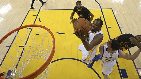Golden State Warriors forward Kevin Durant shoots against the Cleveland Cavaliers during the first half of Game 5 of basketball's NBA Finals in Oakland, California, June 12, 2017. The Warriors won and took the title. Photo by: Ezra Shaw/Pool Photo via AP