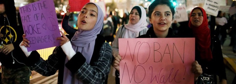Teens protest President Trump's travel ban. Photo: Sandy Huffaker/AFP/Getty Images.