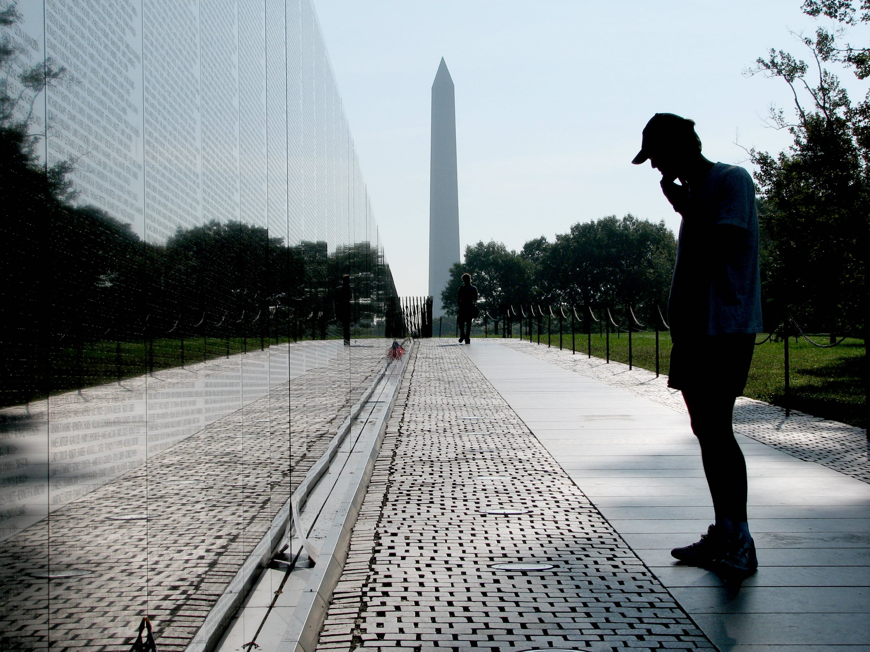 The Vietnam Veterans Memorial In Washington D.C. Two Simple Walls Of  Polished Granite